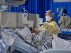 A nurse works on a patient in an Intensive Care Unit (PA)