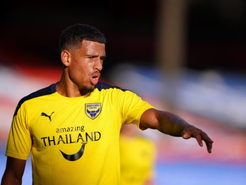 Marcus McGuane has signed a permanent deal with Oxford but will be unable to face Burton due to injury (John Walton/PA)