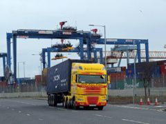 A freight lorry leaves Belfast Port (PA)