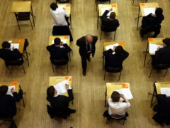 Pupils sitting an exam (David Jones/PA)