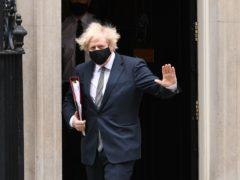 Prime Minister Boris Johnson leaves 10 Downing Street (PA)