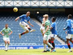 Kemar Roofe heads home his second goal in Rangers' 4-1 Old Firm win over Celtic at Ibrox (Jane Barlow/PA Images).