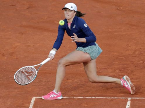 Iga Swiatek battled into the quarter-finals of the Italian Open (Paul White/AP)
