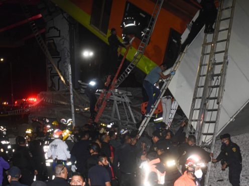 Firefighters and rescue personnel working at the scene (Jose Ruiz/AP)