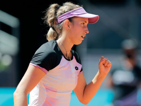 Elise Mertens celebrates winning a point during her victory over Simona Halep (Paul White/AP)