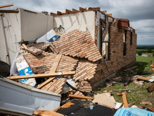 The lodge at the Barn on the Brazos wedding venue is shown after being destroyed by a tornado in Blum, Texas (Yffy Yossifor/Star-Telegram via AP)