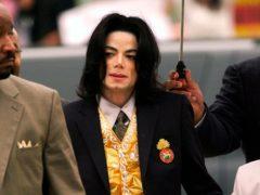 Michael Jackson arrives at the Santa Barbara County Courthouse for his trial in Santa Maria, California (Aaron Lambert/Santa Maria Times via AP, Pool, File)