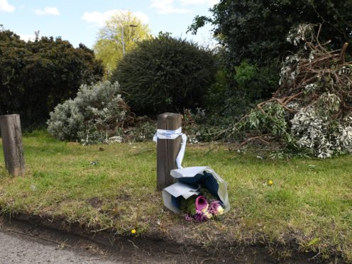 Flowers left at the site where mother Maria Rawlings was found dead (Stefan Rousseau/PA)