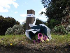 Flowers left at Little Heath, Romford, east London, where Maria Jane Rawlings was found dead (Stefan Rousseau/PA)