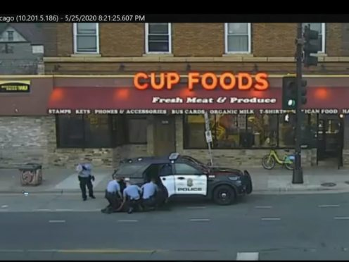 In this May 25, 2020 file image from surveillance video, Minneapolis police Officers from left, Tou Thao, Derek Chauvin, J. Alexander Kueng and Thomas Lane are seen attempting to take George Floyd into custody in Minneapolis, Minn. (Court TV via AP, Pool, File)
