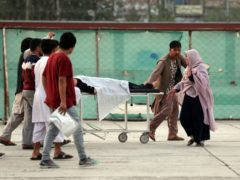 An injured school student is transported to hospital (AP)