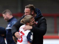 Lloyd Isgrove celebrates with manager Ian Evatt (Gareth Fuller/PA)