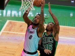 Miami Heat's Trevor Ariza (8) drives to the basket as Boston Celtics' Marcus Smart tries to block (Steven Senne/AP)