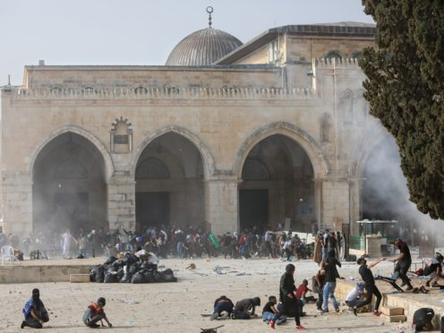 Palestinians clash with Israeli security forces at the Al-Aqsa Mosque compound in Jerusalem's Old City (Mahmoud Illean/AP)