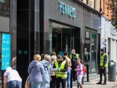 Shoppers queue in Dublin City centre (Damien Storan/PA)