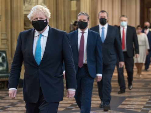 Prime Minister Boris Johnson (left) and Labour leader Sir Keir Starmer (2nd left) walk through the Central Lobby (Stefan Rousseau/PA)