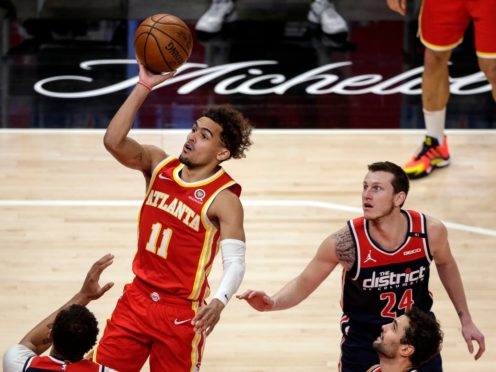 Atlanta Hawks guard Trae Young puts up a shot against the Washington Wizards (Butch Dill/AP).