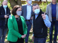 Sinn Fein leader Mary Lou McDonald alongside John Teggart, son of Daniel Teggart, in Ballymurphy, Belfast (Brian Lawless/PA)