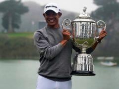 Collin Morikawa holds the Wanamaker Trophy after winning the 2020 US PGA Championship (Jeff Chiu, File/AP)