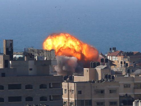Smoke rises following Israeli airstrikes on a building in Gaza City (AP)