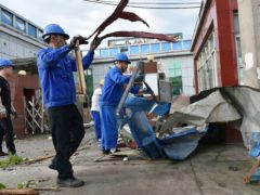 Workers clear debris at a factory that was damaged by a reported tornado in Shengze township in Suzhou (Chinatopix/AP)