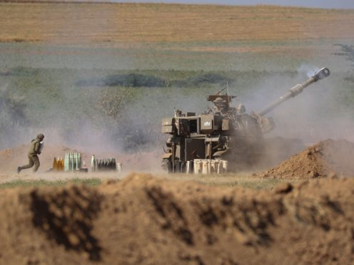 An Israeli artillery unit fires toward targets in the Gaza Strip (AP)