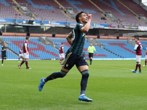 Rodrigo celebrates his first goal in Leeds' victory over Burnley (Martin Rickett/PA)