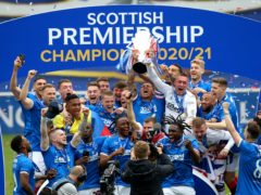 James Tavernier lifts the trophy as Rangers celebrate the title (Andrew Milligan/PA)