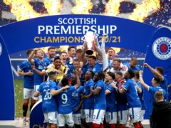Rangers' James Tavernier lifts the Scottish Premiership trophy (Andrew Milligan/PA)