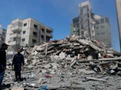 Several buildings collapsed during Israeli air strikes on Gaza City on Sunday (Adel Hana/AP)