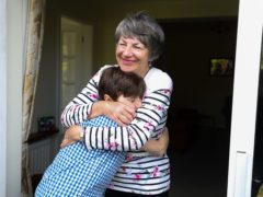 Sue Rickett hugs her grandson Ben for the first time in over a year, in anticipation of lockdown restrictions being eased in England (Martin Rickett/PA)