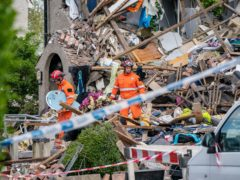 Emergency workers at the scene of the explosion (Danny Lawson/PA)