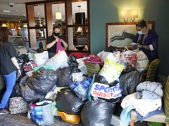 Staff arrange donations at the Hurley Flyer pub in Morecambe in the wake of a suspected gas blast that killed a young child in nearby Heysham (Danny Lawson/PA)