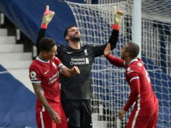Liverpool goalkeeper Alisson Becker celebrates his goal (Rui Vieira/PA)