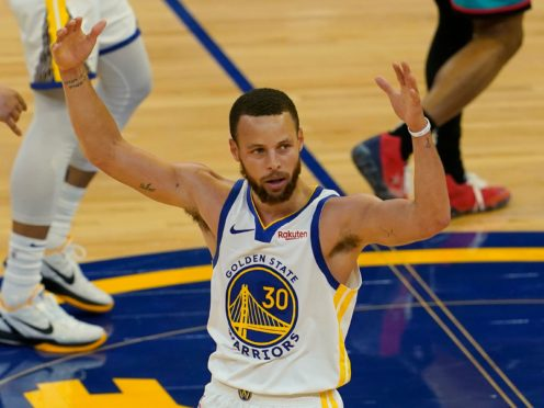 Golden State Warriors guard Stephen Curry gestures after shooting a 3-point basket against the Memphis Grizzlies (Jeff Chiu/AP)