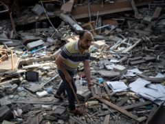 A Palestinian man inspects the damage of a house destroyed by an early morning Israeli airstrike, in Gaza City (AP Photo/Khalil Hamra)