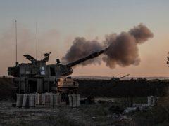 An Israeli artillery unit fires towards targets in the Gaza Strip (Tsafrir Abayov/AP)