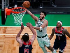 Boston Celtics forward Jayson Tatum drives to the basket against Washington Wizards centre Robin Lopez (Charles Krupa/AP)