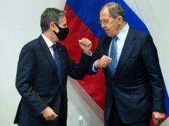 US Secretary of State Antony Blinken, left, greets Russian Foreign Minister Sergey Lavrov in Reykjavik (Saul Loeb/Pool/AP)