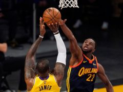 LeBron James lets fly with the three-pointer that proved to be a game winner (Mark J. Terrill/AP)