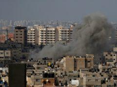 Smoke rises following Israeli airstrikes in Gaza City (Hatem Moussa/AP)