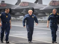 Prime Minister Boris Johnson, along with Commodore Steve Moorhouse and First Sea Lord Admiral Tony Radakin (Leon Neal/PA)