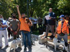 Dog owners take part in a rally against a proposed law by the government related to household pets (Yorgos Karahalis/AP)