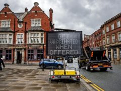 An electronic notice board in Bolton town centre (Peter Byrne/PA)