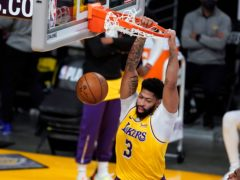 Anthony Davis scored 34 points and had 11 rebounds as his Los Angeles Lakers celebrated hosting their first playoff game in more than eight years with a victory over the Phoenix Suns (Marcio Jose Sanchez/AP)