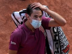 Dominic Thiem heads off court after his shock loss to Pablo Andujar (Christophe Ena/AP)