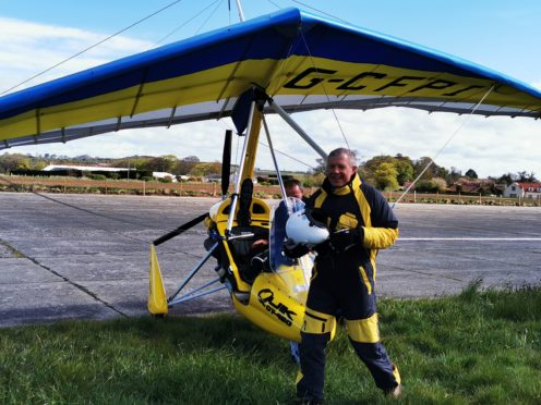 Scottish Liberal Democrat leader Willie Rennie flew in a microlight on the final day of the Holyrood campaign trail (Tom Eden/PA)