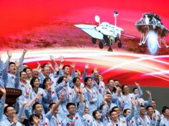 Members at the Beijing Aerospace Control Centre celebrate after China's Tianwen-1 probe successfully landed on Mars (Jin Liwang/Xinhua via AP/PA)