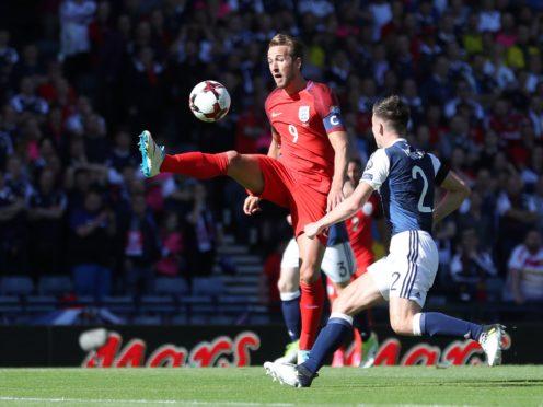 England's Harry Kane (left) and Scotland's Kieran Tierney battle for the ball in 2017 (Martin Rickett/PA)