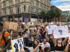 People participate in a Black Lives Matter protest rally march through Donegall Square in Belfast (David Young/PA)